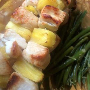 White meat chicken should be marinated for at least an hour to insure moist results. Grilling between fruit helps too!